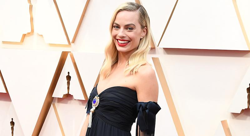 Margot Robbie swears by Peter Thomas Roth's Complexion Correction Pads for glowing skin. (Getty Images)