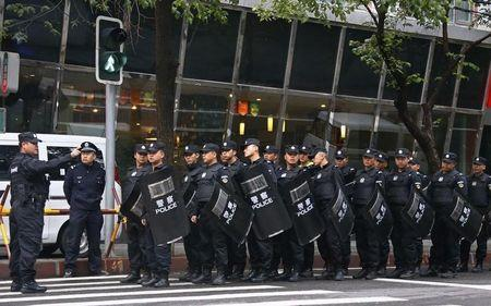 Police block a street leading to the site of an explosives attack, in downtown Urumqi