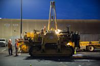 Workers prepare heavy machinery in response to a derailed Amtrak train in Philadelphia, Pennsylvania May 13, 2015. An Amtrak passenger train with more than 200 passengers on board derailed in north Philadelphia on Tuesday night, killing at least five people and injuring more than 50 others, several of them critically, authorities said. Authorities said they had no idea what caused the train wreck, which left some demolished rail cars strewn upside down and on their sides in the city's Port Richmond neighborhood along the Delaware River. REUTERS/Lucas Jackson
