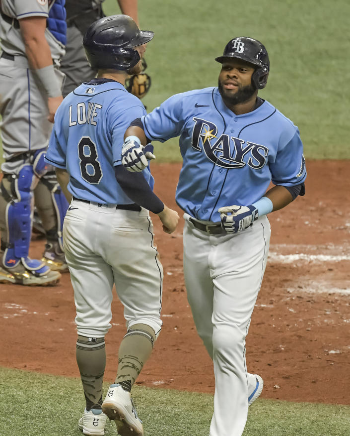 Tampa Bay Rays' Brandon Lowe (8) congratulates Manuel Margot after Margot's two-run home run off New York Mets' Marcus Stroman during the fourth inning of a baseball game Sunday, May 16, 2021, in St. Petersburg, Fla. (AP Photo/Steve Nesius)