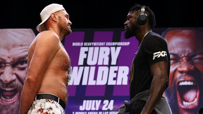 Tyson Fury, left, and Deontay Wilder in Los Angeles on June 15, 2021. / Credit: Mikey Williams/Top Rank Inc/ Getty