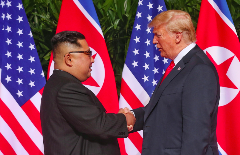 Kim Jong-un and Donald Trump shake hands at their summit in Singapore in June (Picture: Rex)