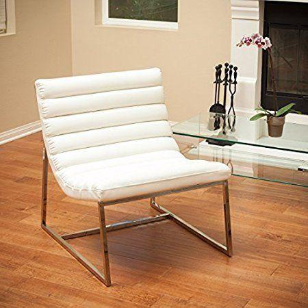 "This eclectic chair has cushioned rolls for extra comfort. Get it on <a href=""https://www.amazon.com/Kingsbury-White-Leather-Lounge-Accent/dp/B008SCT86O/ref=sr_1_26?s=furniture&ie=UTF8&qid=1508437128&sr=1-26&refinements=p_n_feature_keywords_browse-bin%3A7802126011"" target=""_blank"">Amazon</a>."