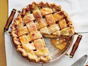 """<p>The heirloom apple that makes this <a href=""""https://www.southernliving.com/food/entertaining/apple-pie-recipes"""" rel=""""nofollow noopener"""" target=""""_blank"""" data-ylk=""""slk:apple pie"""" class=""""link rapid-noclick-resp"""">apple pie</a> so tasty hails from Benton County, Arkansas. What makes it so special? The fragrant, tart, and tasty apple ripens to a deep red while still on the tree, but it continues to ripen after it is picked and transforms to a nearly black hue. Keep an eye out for these beautiful apples for your <a href=""""https://www.southernliving.com/food/holidays-occasions/thanksgiving-pies"""" rel=""""nofollow noopener"""" target=""""_blank"""" data-ylk=""""slk:Thanksgiving pie"""" class=""""link rapid-noclick-resp"""">Thanksgiving pie</a>. The Arkansas Black Apple Pie just needs a drizzle of Caramel Sauce and a scoop of ice cream to make your night perfect.</p> <p><a href=""""https://www.myrecipes.com/recipe/arkansas-black-apple-pie-caramel-sauce"""" rel=""""nofollow noopener"""" target=""""_blank"""" data-ylk=""""slk:Arkansas Black Apple Pie with Caramel Sauce Recipe"""" class=""""link rapid-noclick-resp"""">Arkansas Black Apple Pie with Caramel Sauce Recipe</a></p>"""