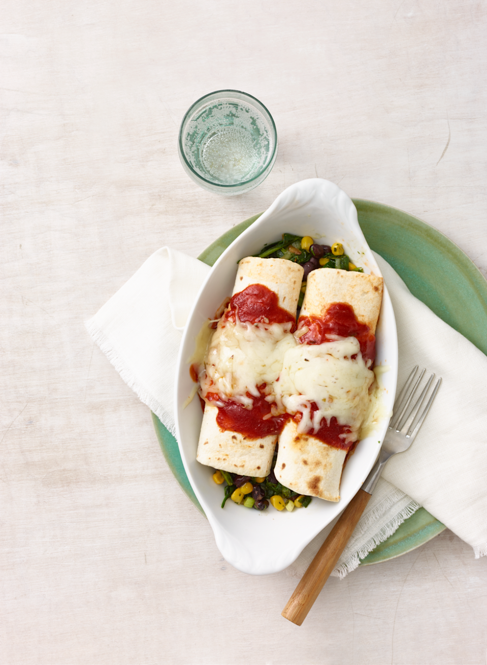 "<p>No meat needed in this vegetarian-friendly enchilada.</p><p><em><a href=""https://www.goodhousekeeping.com/food-recipes/a16370/black-bean-corn-spinach-enchiladas-recipe-wdy0315/"" rel=""nofollow noopener"" target=""_blank"" data-ylk=""slk:Get the recipe for Black Bean, Corn, and Spinach Enchiladas »"" class=""link rapid-noclick-resp"">Get the recipe for Black Bean, Corn, and Spinach Enchiladas » </a></em><br></p>"