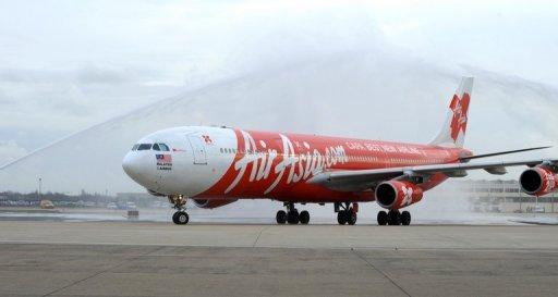 The long-haul arm of budget carrier AirAsia said Monday it would suspend operations to Iran