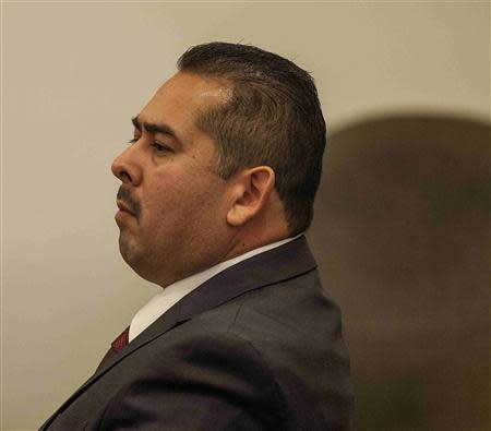 Former Fullerton police officer Manuel Ramos listens as his attorney, John Barnett (now shown) gives his opening statements in the People v. Ramos and Cicinelli trial at Orange County Superior Court in Santa Ana, California, December 2, 2013. REUTERS/Bruce Chambers/Pool