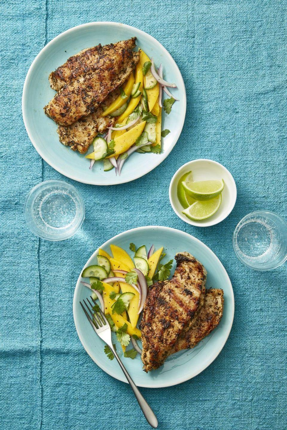 """<p>With so many flavors at hand — fresh citrus, the marriage of cilantro and spicy jerk notes, and more — you won't regret the fact that this dinner is free of hefty carbs. At 275 calories, you'll be shocked it's so flavorful in the first place! </p><p><a href=""""https://www.womansday.com/food-recipes/food-drinks/a21053525/grilled-jerk-chicken-with-mango-cucumber-salad-recipe/"""" rel=""""nofollow noopener"""" target=""""_blank"""" data-ylk=""""slk:Get the recipe from Woman's Day »"""" class=""""link rapid-noclick-resp""""><em>Get the recipe from Woman's Day » </em></a></p>"""