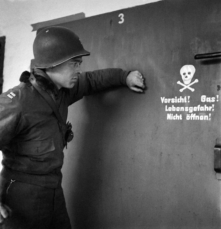 A picture taken in April 1945 shows a US soldier in front of the door of a gas chamber at the Nazi concentration camp of Dachau after its liberation by Allied troops (AFP Photo/Eric Schwab)