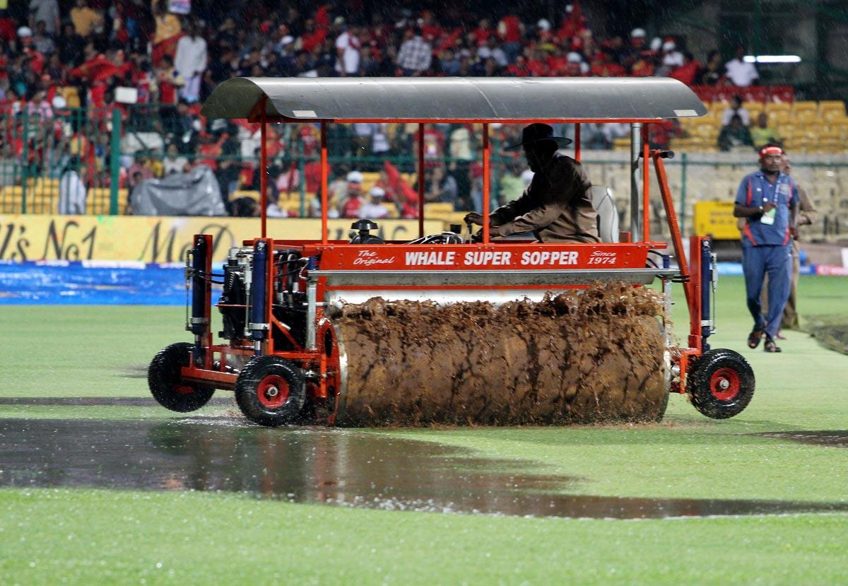 A supper sopper being pressed to service as rains delay the start of the match 70 of the Pepsi Indian Premier League between The Royal Challengers Bangalore and The Chennai Super Kings held at the M. Chinnaswamy Stadium, Bengaluru  on the 18th May 2013. (BCCI)