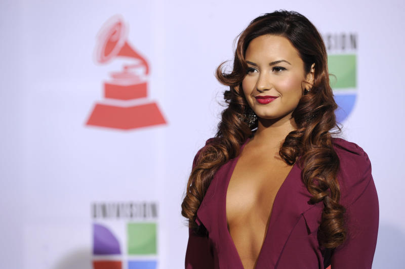 Demi Lovato arrives at the 12th Annual Latin Grammy Awards on Thursday Nov. 10, 2011 in Las Vegas. (AP Photo/Chris Pizzello)