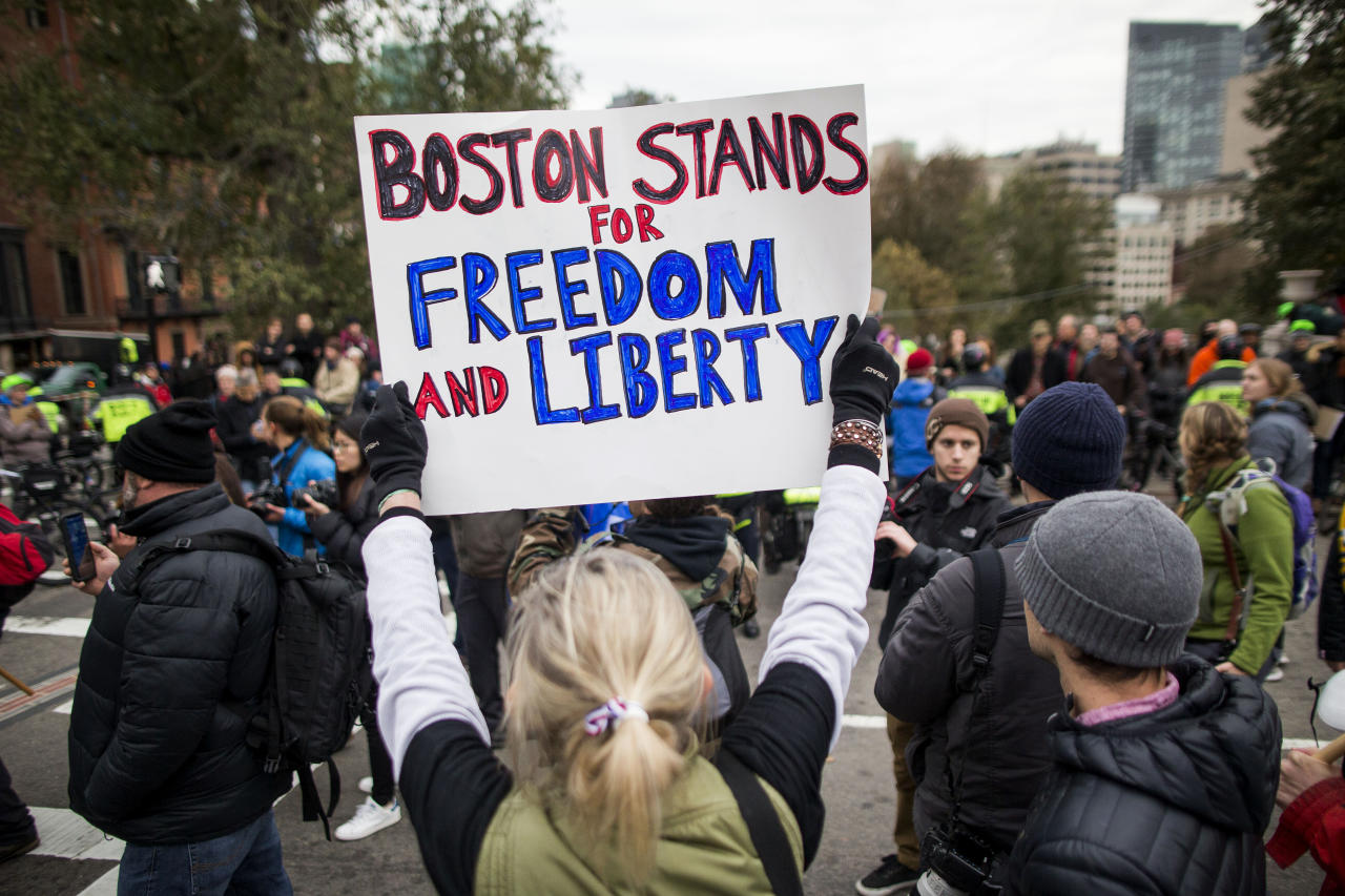 "<p>A participant of an Alt-Right organized free speech event holds a sign that says ""Boston Stands For Freedom And Liberty"" across from the Massachusetts State House on Nov. 18, 2017, in Boston, Mass. (Photo: Scott Eisen/Getty Images) </p>"