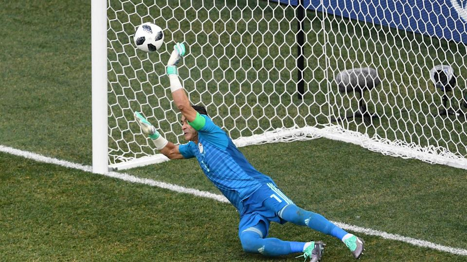 Essam El Hadary became the oldest player in World Cup history on Monday and marked the occasion with a penalty save.