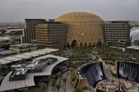 The Al Wasl Dome and the Water Feature are seen at sunset at Expo 2020, in Dubai, United Arab Emirates, Sunday, Oct. 3, 2021. (AP Photo/Jon Gambrell)