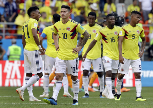 Colombia's James Rodriguez, front, and his teammates walk on the poitch after the group H match between Colombia and Japan at the 2018 soccer World Cup in the Mordavia Arena in Saransk, Russia, Tuesday, June 19, 2018. (AP Photo/Mark Baker)