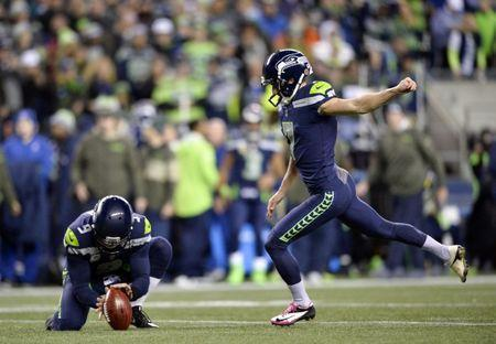 Nov 20, 2017; Seattle, WA, USA; Seattle Seahawks kicker Blair Walsh (7) kicks an extra point during the first half against the Atlanta Falcons at CenturyLink Field. Atlanta defeated Seattle 34-31. Steven Bisig-USA TODAY Sports