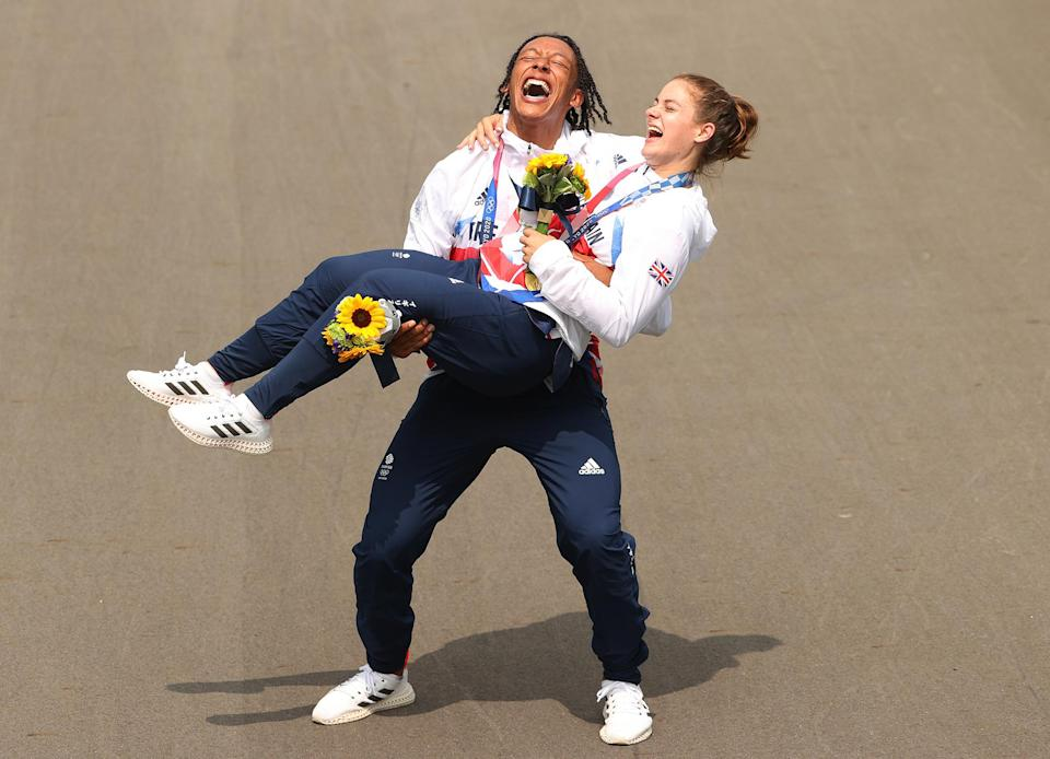 <p>Silver medalist Kye Whyte and gold medalist Bethany Shriever of Great Britain pose for a photograph while celebrating at the medal ceremony after the July 30 women's BMX final.</p>