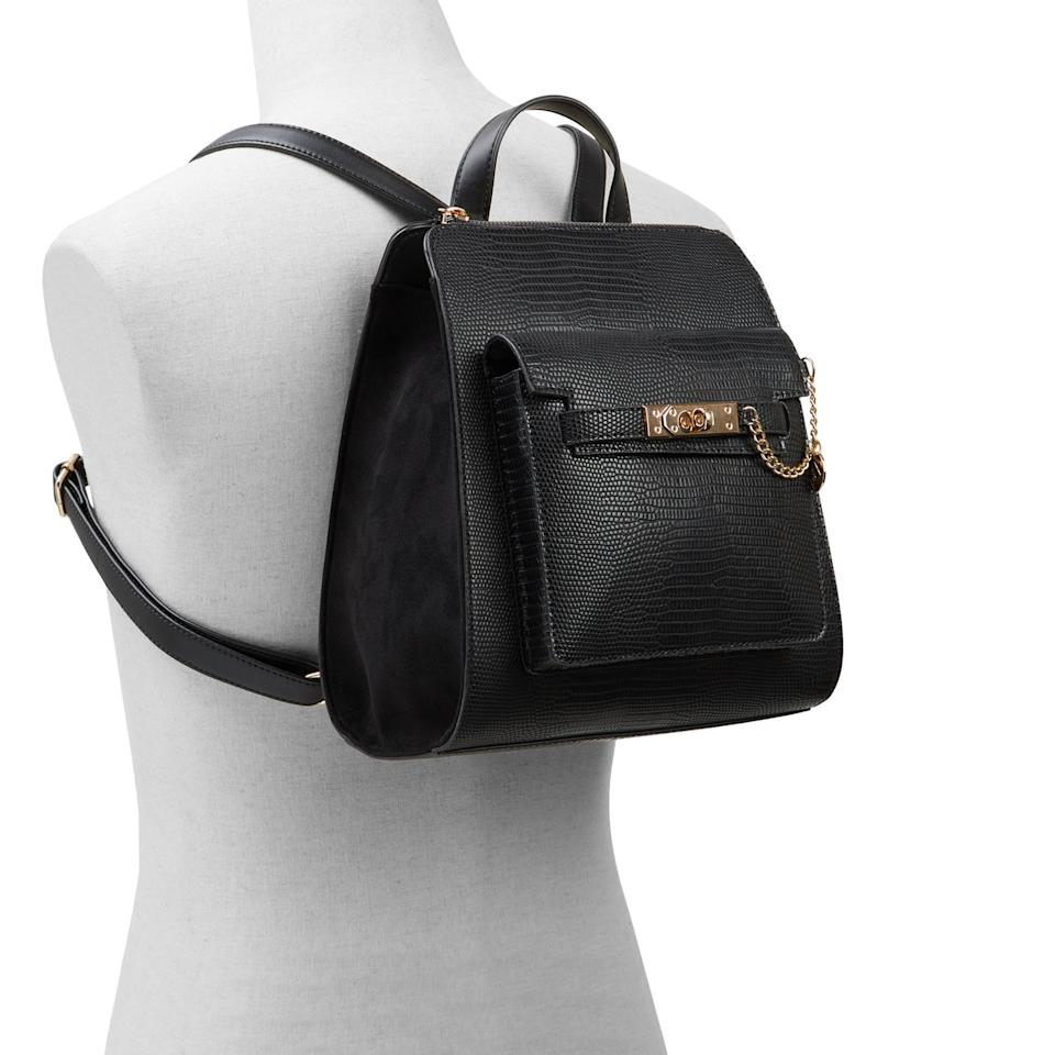 Allow Backpack in black with gold chain detail. Image via Call It Spring.