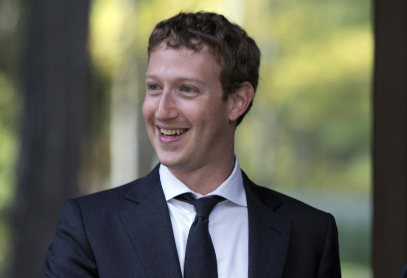 FILE-In this Monday, Oct. 1, 2012, file photo, Facebook CEO Mark Zuckerberg, smiles for photographers at the Gorki residencewhile meeting with the Russian Prime Minister Dmitry Medvedev in Moscow. Facebook's third-quarter results released Tuesday, Oct. 23, 2012, inched past Wall Street's expectations, offering evidence that the company is making inroads in mobile advertising, a longtime concern among investors. (AP Photo/Alexander Zemlianichenko, pool)