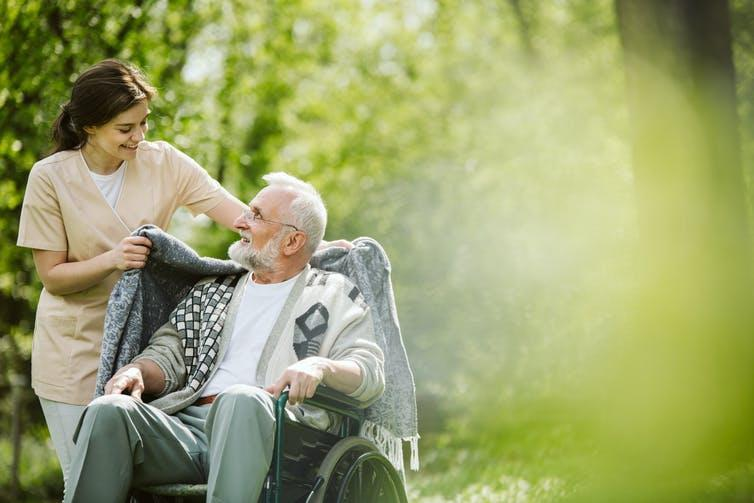 Picture of an elderly man with a nurse.