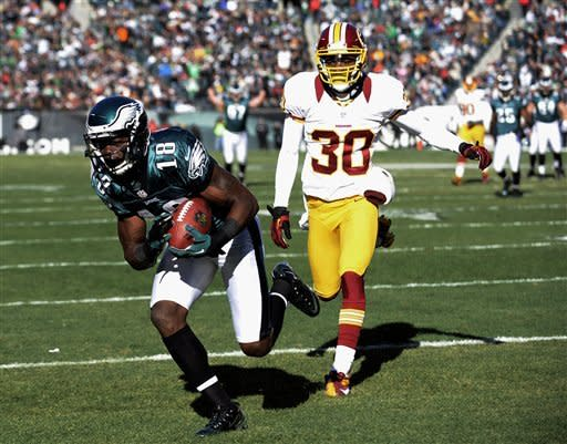 Philadelphia Eagles' Jeremy Maclin, left, pulls in a touchdown pass against Washington Redskins' D.J. Johnson in the first half of an NFL football game on Sunday, Dec. 23, 2012, in Philadelphia. (AP Photo/Michael Perez)