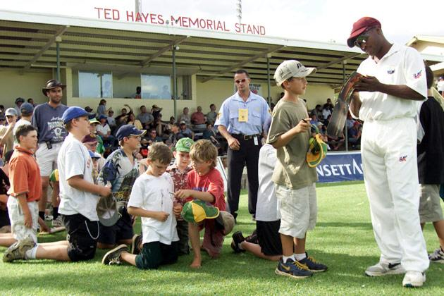 13 Nov 2000:  Brian Lara of the West Indies signs autographs, during the match between the Northern Territory Invitational XI and the West Indies, played at Traeger Park, Alice Springs, Australia. X DIGITAL IMAGE Mandatory Credit: Hamish Blair/ALLSPORT