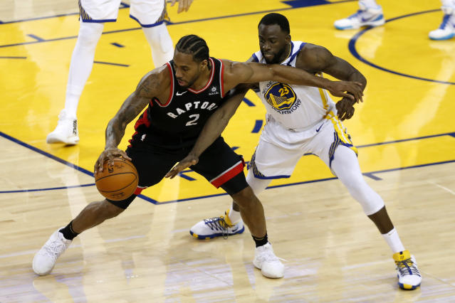 Kawhi Leonard #2 of the Toronto Raptors is defended by Draymond Green #23 of the Golden State Warriors in the second half during Game Three of the 2019 NBA Finals at ORACLE Arena on June 05, 2019 in Oakland, California. (Photo by Lachlan Cunningham/Getty Images)