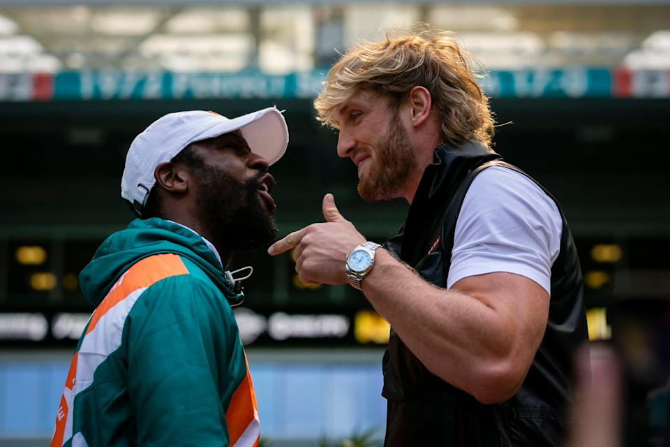 <p>Floyd Mayweather and Logan Paul square up at a recent promotional event</p> (AFP via Getty Images)