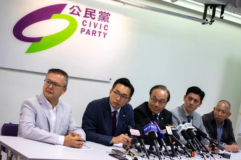 Leaders of the Civic Party attend at a news conference after the local district council election in Hong Kong