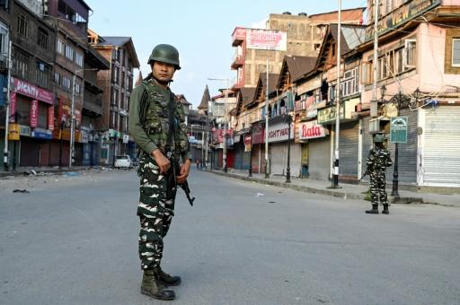 Tens of thousands of Indian troops have enforced a lockdown in Kashmir