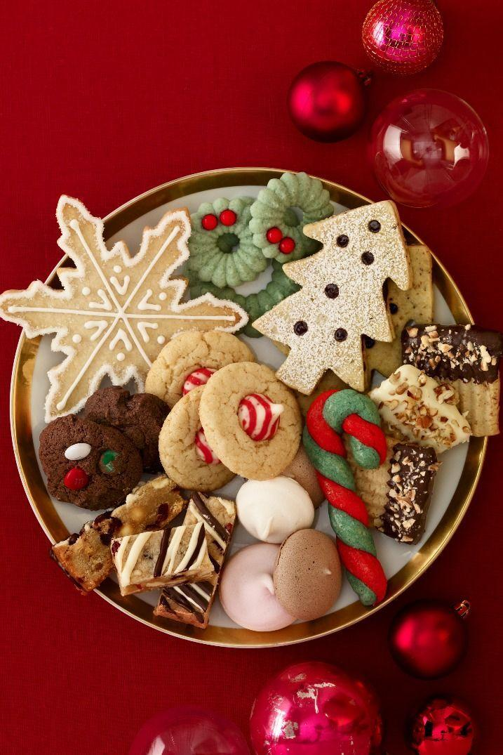 """<p>Invite your pals to swing by with a dozen <a href=""""https://www.countryliving.com/food-drinks/g647/holiday-cookies-1208/"""" rel=""""nofollow noopener"""" target=""""_blank"""" data-ylk=""""slk:cookies"""" class=""""link rapid-noclick-resp"""">cookies</a> in tow. Crank up the holiday tunes, nosh on cookies, and then send everyone packing with a bag full of treats. Set out cute recipe cards so guests can share how-tos for their new favorite desserts.</p>"""
