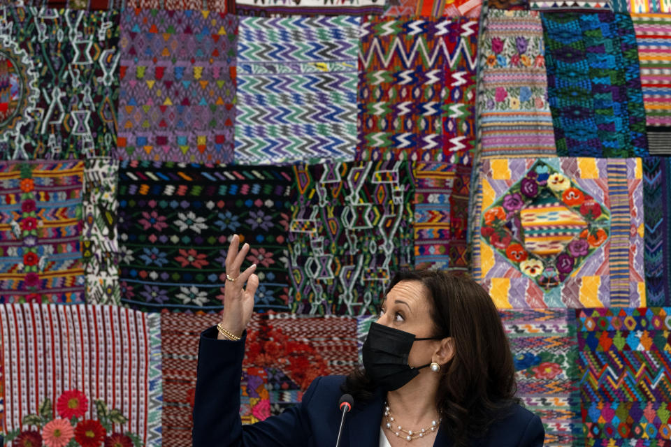 Vice President Kamala Harris gestures in front of traditional textiles as she attends a meeting with Guatemalan women entrepreneurs at the Universidad del Valle de Guatemala, in Guatemala City, Monday, June 7, 2021. (AP Photo/Jacquelyn Martin)