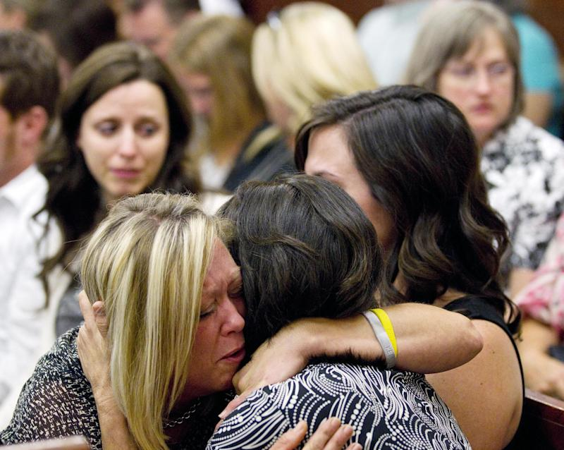 Mindy Danaher embraces a supporter as she reacts to the guilty verdict against her husband's killer Raul Rodriguez  Wednesday, June 13, 2012, in Houston.  A jury convicted Rodriguez of murdering his neighbor during a confrontation outside the neighbor's home two years ago, rejecting his claim that he was within his rights to fatally shoot the man under Texas' version of a stand-your-ground law. (AP Photo/Houston Chronicle, Brett Coomer) MANDATORY CREDIT