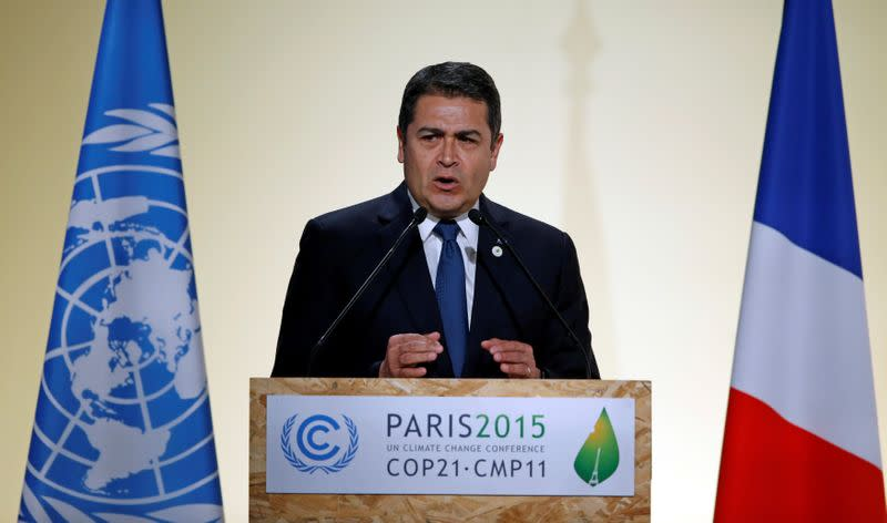 FILE PHOTO: Honduran President Hernandez Alvarado delivers a speech for the opening day of the World Climate Change Conference 2015 (COP21) at Le Bourget, near Paris