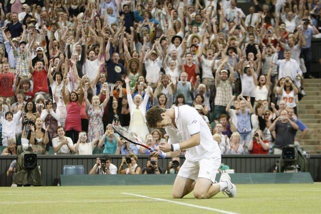 Andy Murray falls to his knees after defeating Stan Wawrinka under the centre court roof in 2009