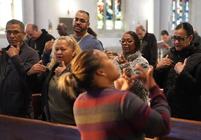 "<span class=""caption"">Deaf worshippers sign a hymn while following sign language interpreter Diely Martinez at Holyrood Episcopal Church-Iglesia Santa Cruz in New York City, Sunday, Dec. 15, 2019.</span> <span class=""attribution""><a class=""link rapid-noclick-resp"" href=""http://www.apimages.com/metadata/Index/Religion-Deaf-Worshippers/18db10f4f69a49e28134d52d64f9736f/1/0"" rel=""nofollow noopener"" target=""_blank"" data-ylk=""slk:AP Photo/Emily Leshner"">AP Photo/Emily Leshner</a></span>"
