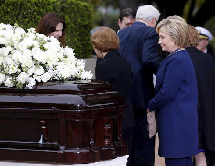<p>Former first lady Rosalynn Carter, center, greets Patti Davis, daughter of former President Ronald Reagan and Nancy Reagan, as she and former first lady Hillary Clinton pay their respects during the funeral for Nancy Reagan.<i> (Photo: Mike Blake/Reuters)</i></p>