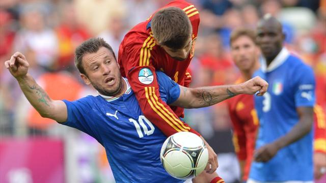 Italian forward Antonio Cassano (L) vies with Spanish defender Gerard Pique during the Euro 2012 championships football match Spain vs Italy on June 10, 2012 at the Gdansk Arena