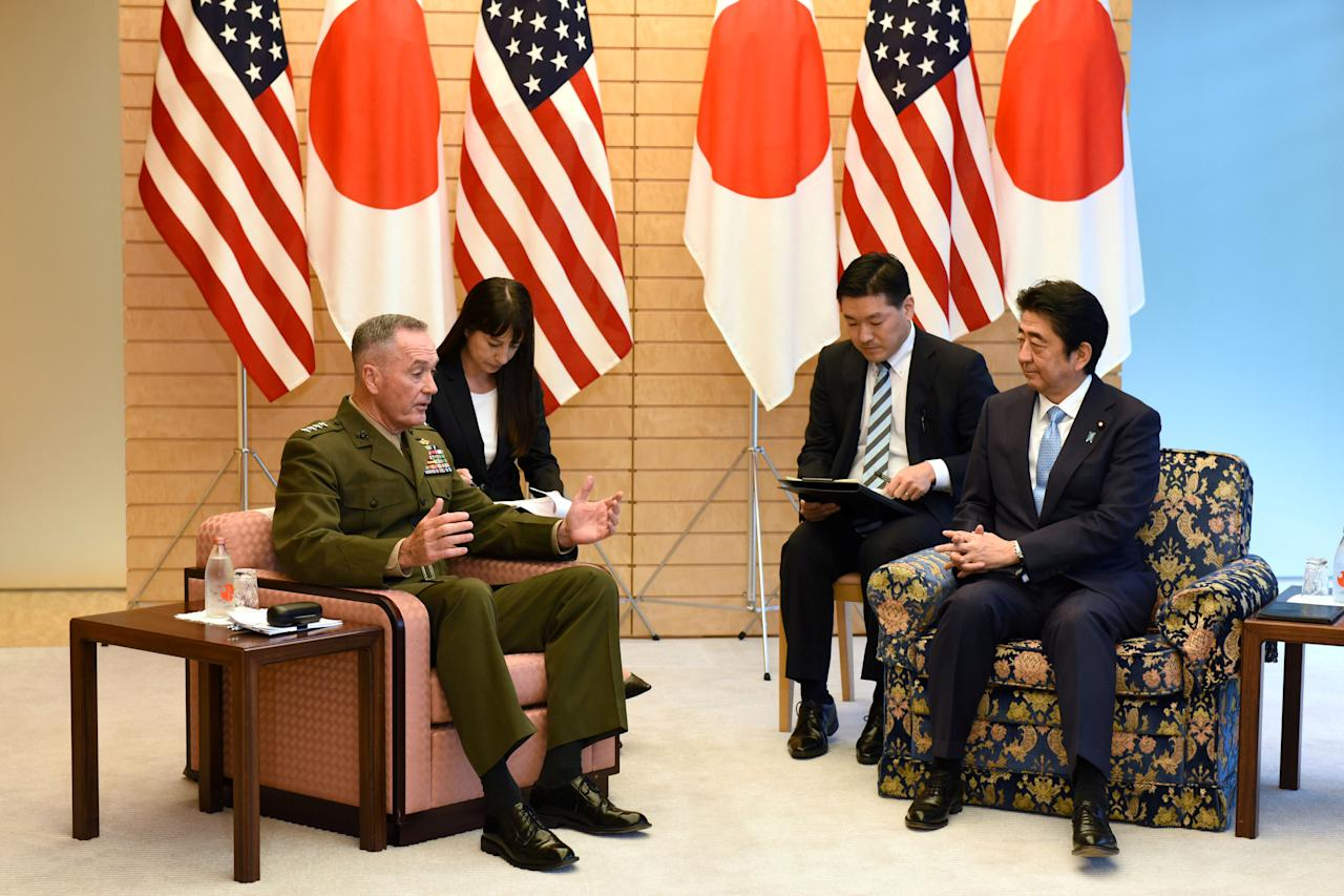 General Joseph Dunford (L), the chairman of the U.S. Joint Chiefs of Staff, meets with Japan's Prime Minister Shinzo Abe (R) at Abe's official residence in Tokyo, Japan August 18, 2017. REUTERS/Kazuhiro Nogi/Pool     TPX IMAGES OF THE DAY