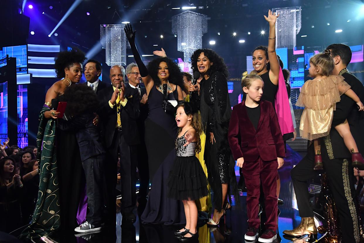LOS ANGELES, CA - NOVEMBER 19: Guests, such as Smokey Robinson (2nd L), Berry Gordy (3rd L), host Tracee Ellis Ross (center R) stand onstage as Rhonda Ross Kendrick (L) presents the Lifetime Achievement award to honoree Diana Ross (center L) during the 2017 American Music Awards at Microsoft Theater on November 19, 2017 in Los Angeles, California. (Photo by Jeff Kravitz/AMA2017/FilmMagic for dcp)