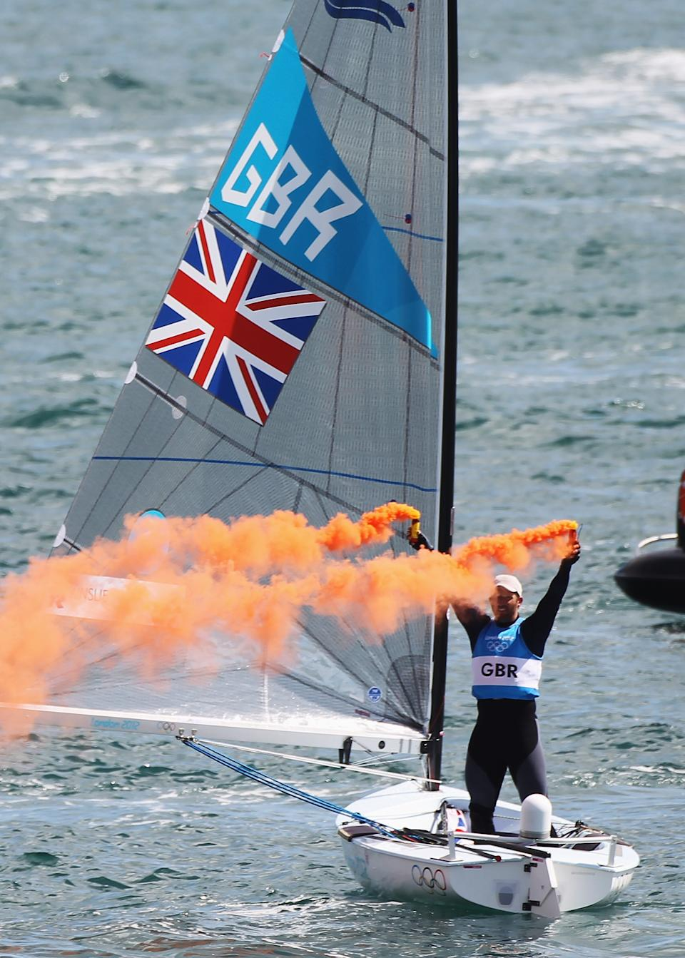 WEYMOUTH, ENGLAND - AUGUST 05: Ben Ainslie of Great Britain celebrates overall victory after competing in the Men's Finn Sailing Medal Race on Day 9 of the London 2012 Olympic Games at the Weymouth & Portland Venue at Weymouth Harbour on August 5, 2012 in Weymouth, England. (Photo by Getty Images)