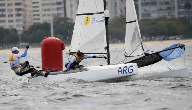 2016 Rio Olympics - Sailing - Final - Mixed Multihull - Nacra 17 - Medal Race - Marina de Gloria - Rio de Janeiro, Brazil - 16/08/2016. Santiago Lange (ARG) of Argentina and Cecilia Carranza (ARG) of Argentina compete. REUTERS/Brian Snyder FOR EDITORIAL USE ONLY. NOT FOR SALE FOR MARKETING OR ADVERTISING CAMPAIGNS.