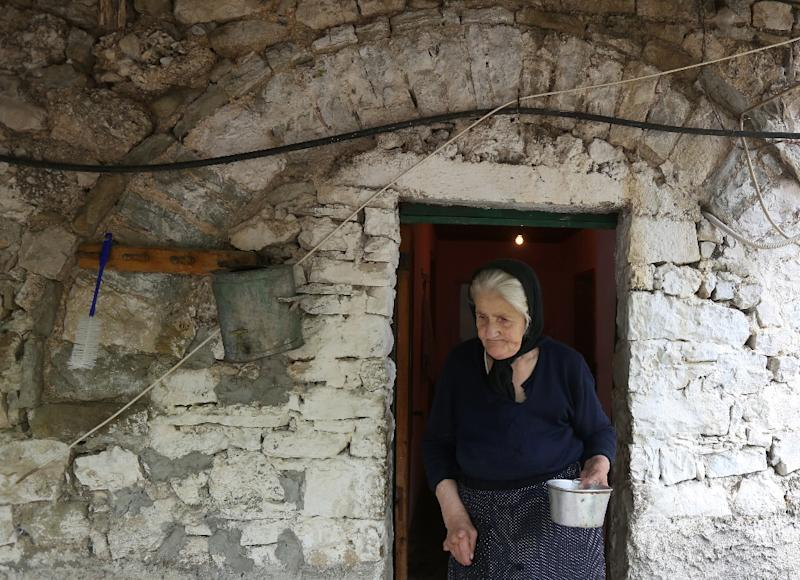 Krisanthi Papa, 72, pictured at her home in the Albanian village of Qesarat, on June 30, 2015 (AFP Photo/Gent Shkullaku)