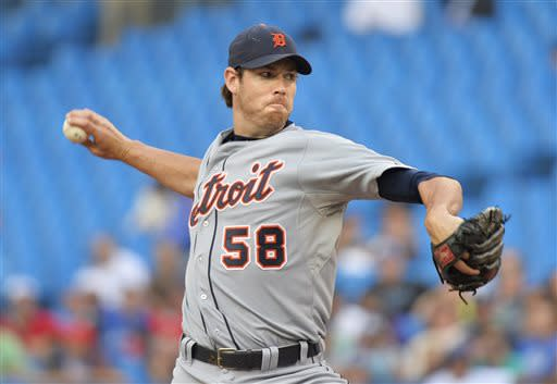Detroit Tigers starting pitcher Doug Fister works against the Toronto Blue Jays during the first inning of a baseball game in Toronto on Tuesday, July 2, 2013. (AP Photo/The Canadian Press, Nathan Denette)