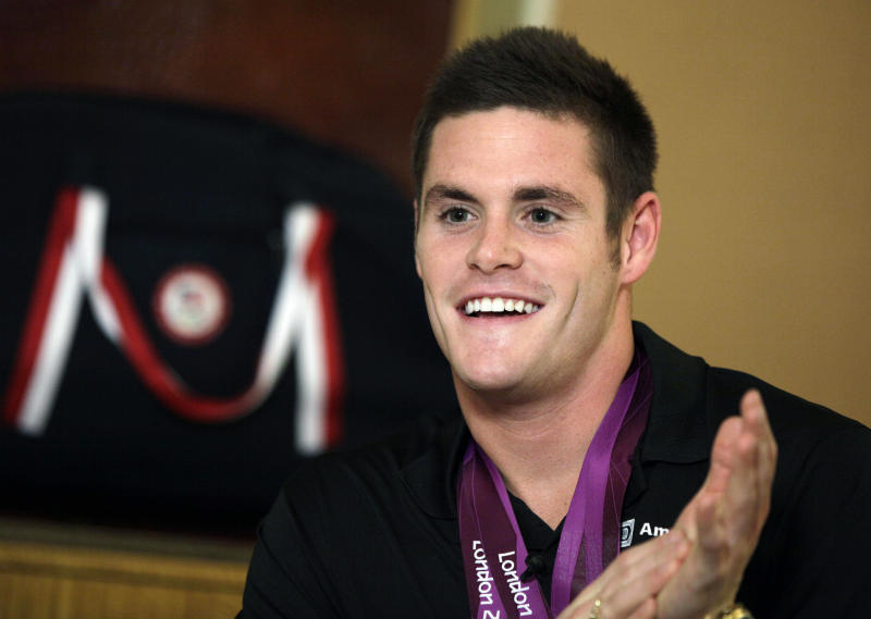 David Boudia, who came back from the 2012 London Summer Olympics having won both gold and bronze in diving, speaks during an interview, Monday, Aug. 13, 2012, in New York. (AP Photo/Richard Drew)