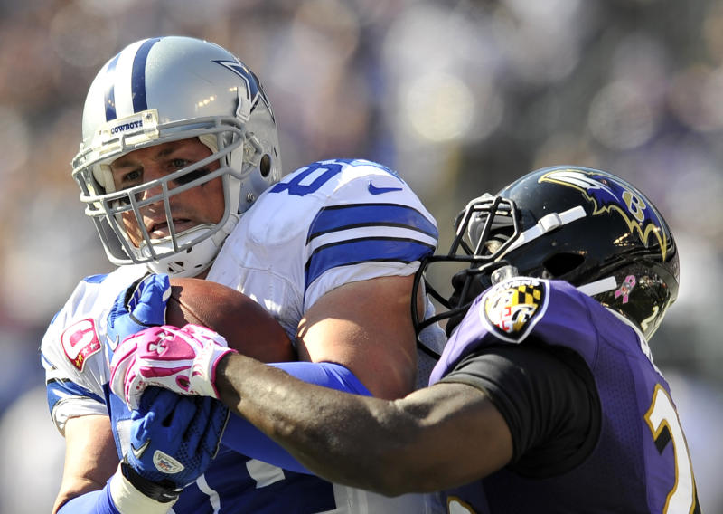 Dallas Cowboys tight end Jason Witten, left, is tackled by Baltimore Ravens free safety Ed Reed in the second half of an NFL football game in Baltimore, Sunday, Oct. 14, 2012. (AP Photo/Gail Burton)