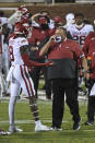 Arkansas coach Sam Pittman talks to wide receiver Mike Woods (8) during the second half of the team's NCAA college football game against Mississippi State in Starkville, Miss., Saturday, Oct. 3, 2020. Arkansas won 21-14. (AP Photo/Thomas Graning)