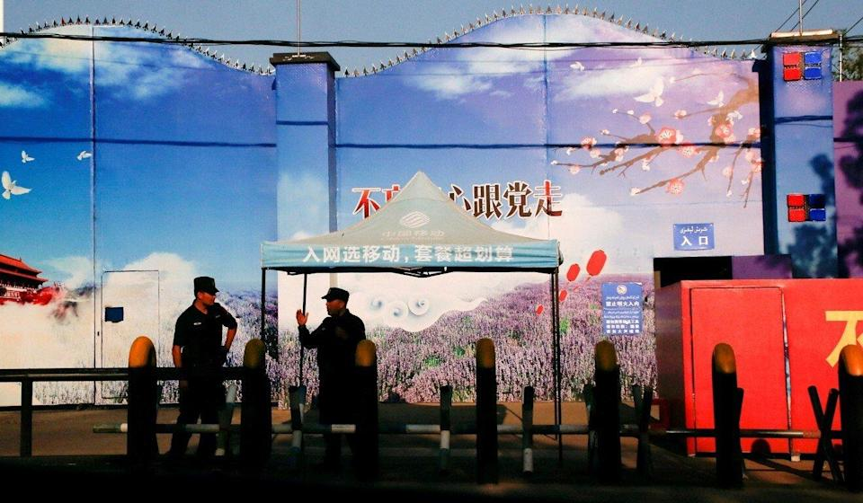 Security guards stand at the gates of what is officially known as a vocational skills education centre in Huocheng county in Xinjiang Uygur autonomous region. Photo: Reuters