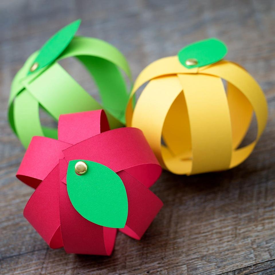 """<p>This craft is incredibly easy, and yet looks almost professional when finished. Make a few for a fun, kid-made fall centerpiece. </p><p><em><a href=""""https://www.firefliesandmudpies.com/easy-paper-strip-apple-craft-for-kids/"""" rel=""""nofollow noopener"""" target=""""_blank"""" data-ylk=""""slk:Get the tutorial at Fireflies and Mudpies »"""" class=""""link rapid-noclick-resp"""">Get the tutorial at Fireflies and Mudpies »</a></em></p>"""