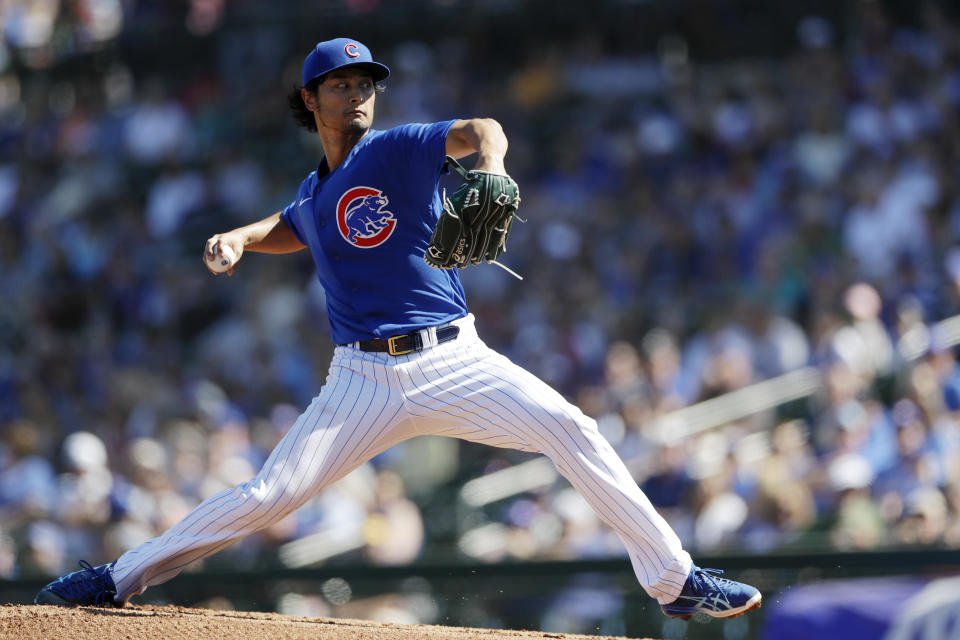 Chicago Cubs starting pitcher Yu Darvish, of Japan, works against a Milwaukee Brewers batter during the first inning of a spring training baseball game Saturday, Feb. 29, 2020, in Mesa, Ariz. (AP Photo/Gregory Bull)